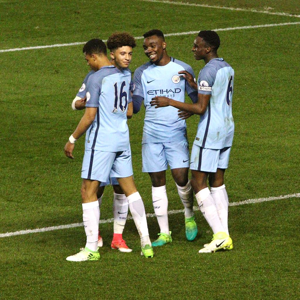 Lukas Nmecha celebrates his goal with Jadon Sancho, Thierry Ambrose and Rodney Kongolo