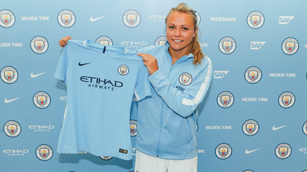 Claire Emslie with her new Man City Women shirt
