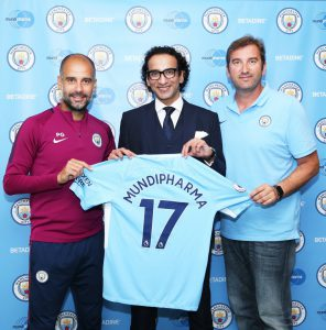 Manchester City Manager, Pep Guardiola, Mundipharma CEO, Raman Singh, and Manchester City CEO, Ferran Soriano