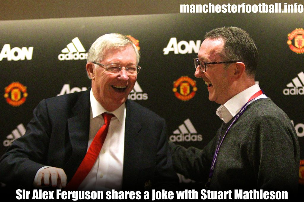 Sir Alex Ferguson shares a joke with Stuart Mathieson upon his retirement from the Manchester Evening News