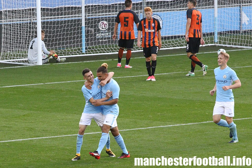 Phil Foden congratulates Joel Latibeaudiere on his goal for Man City U19 against Shakhtar Donetsk
