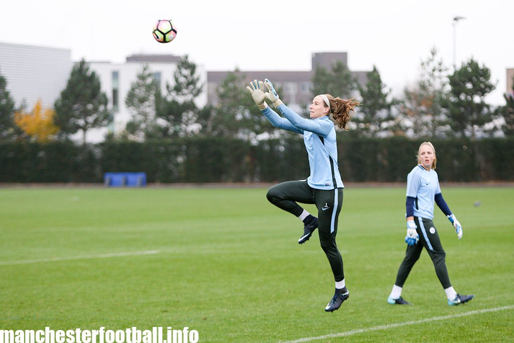 Manchester City goalkeeper Karen Bardsley in catching practice with Ellie Roebuck looking on