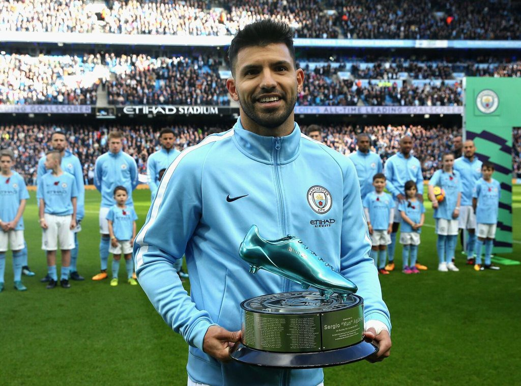 Sergio Aguero receives a Blue Boot award for breaking Manchester City's all-time goalscoring record
