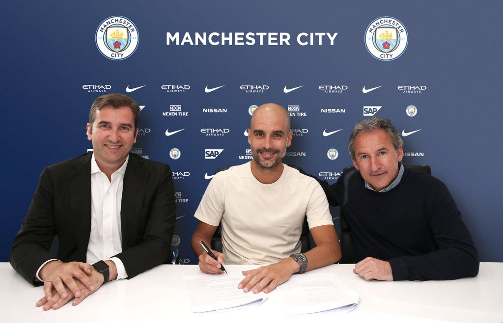 Ferran Soriano (left) and Txiki Begiristain (right) with Pep Guardiola as he signs his new Man City contract which runs to 2021