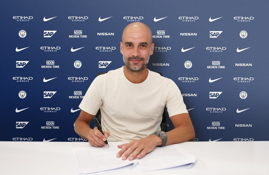 Pep Guardiola signs new contract to stay at Man City until 2021