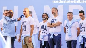 Pep Guardiola and his coaching staff (including Domenec Torrent - second right - and Mikel Arteta - far right) at the Manchester City title Parade on May 14, 2018