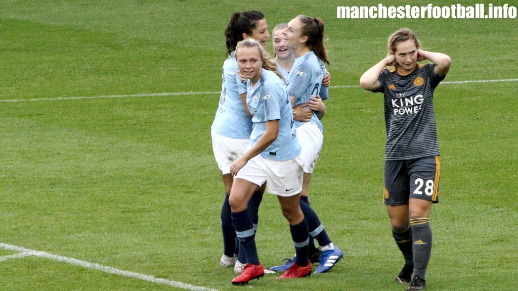 Nadia Nadim, Claire Emslie, and Jess Park (left to right) celebrate Tessa Wullaert's first goal for Manchester City women to the dismay of Leicester City Women's player Maddy Cusack