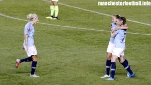 Steph Houghton runs over to celebrate a goal against Barcelona with Claire Emslie and goalscorer Mel Lawley