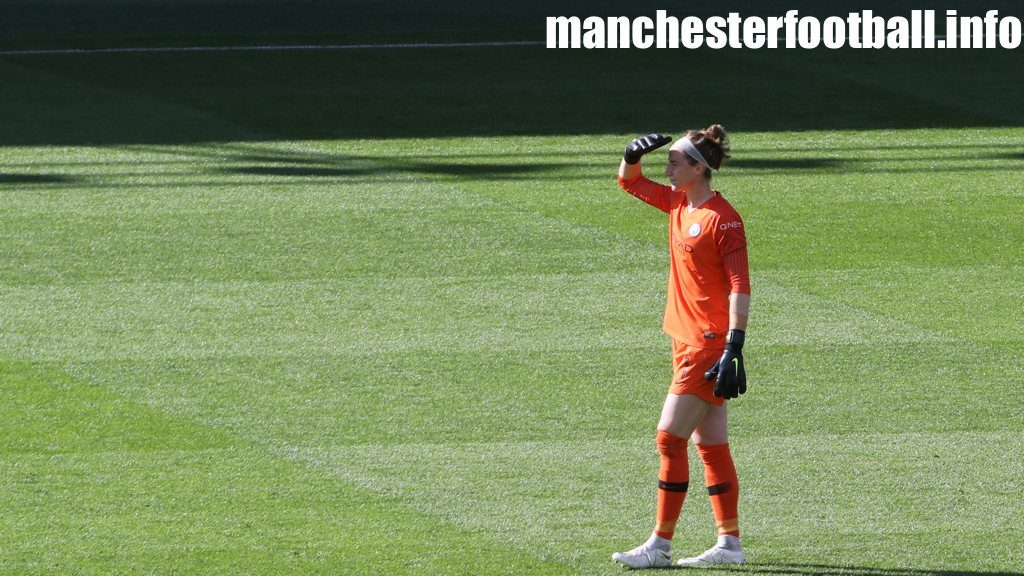 Karen Bardsley shielding her eyes against the sun