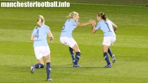 Gemma Bonner and Steph Houghton rush to celebrate with goalscorer against Reading - Georgia Stanway