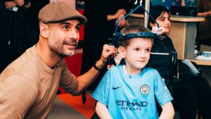 Pep Guardiola shares moment with patient at Royal Manchester Children's Hospital