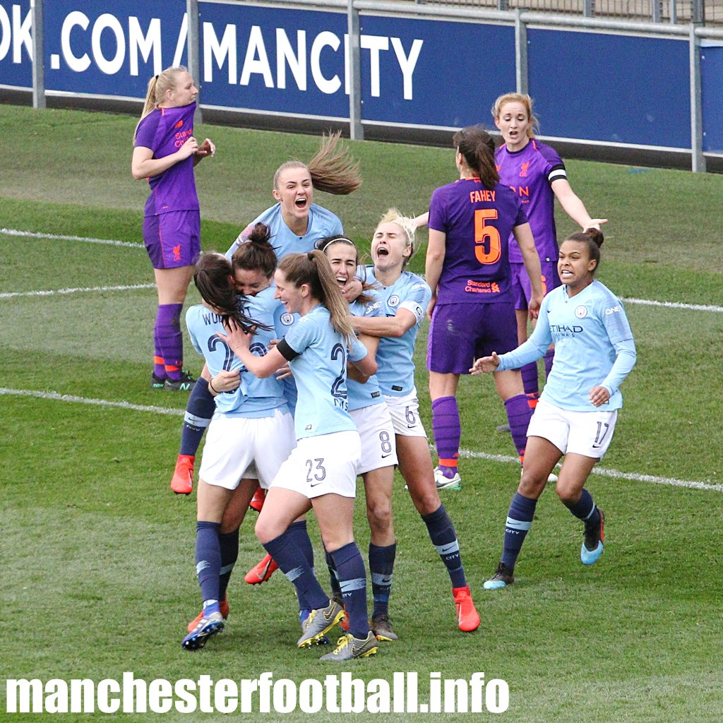 Manchester City players celebrate Jen Beattie's injury time winner against Liverpool Women on Sunday, March 31 2019