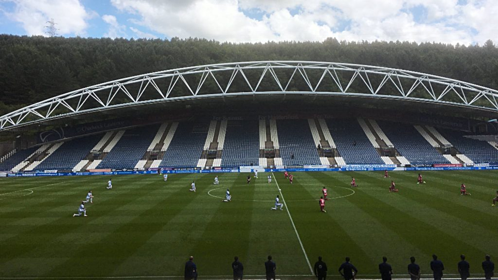 Huddersfield Town vs Wigan Athletic - Players take a knee at John Smiths Stadium prior to kick off on Saturday June 20 2020