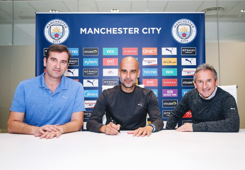 Pep Guardiola flanked by Ferran Soriano and Txiki Begiristain - new Manchester City contract until 2023