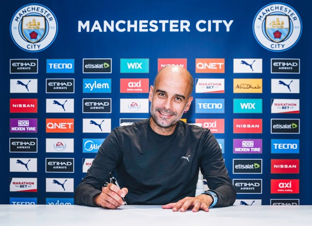 Pep Guardiola signs new contract to stay at Manchester City until 2023
