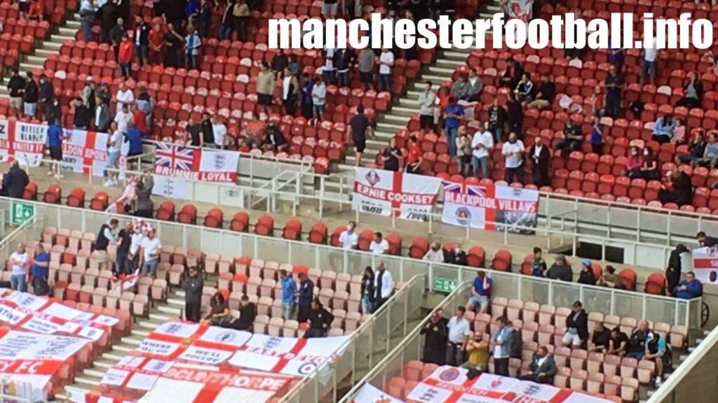 England vs Romania Oldham Athletic fans with Ernie Cooksey flag - Riverside Stadium Friendly - Sunday June 6 2021