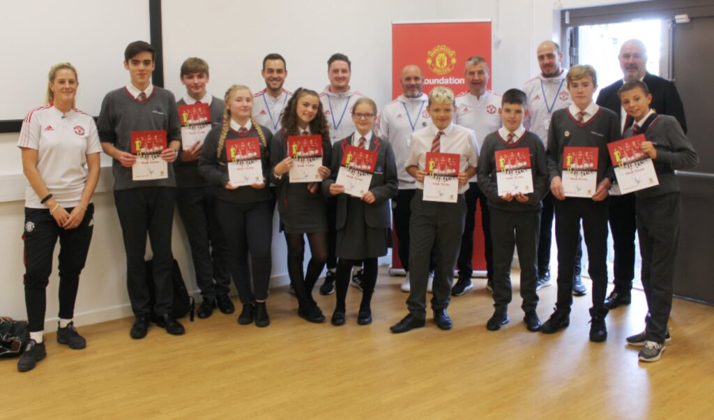 Denis Irwin with students at Central Academy in Carlisle